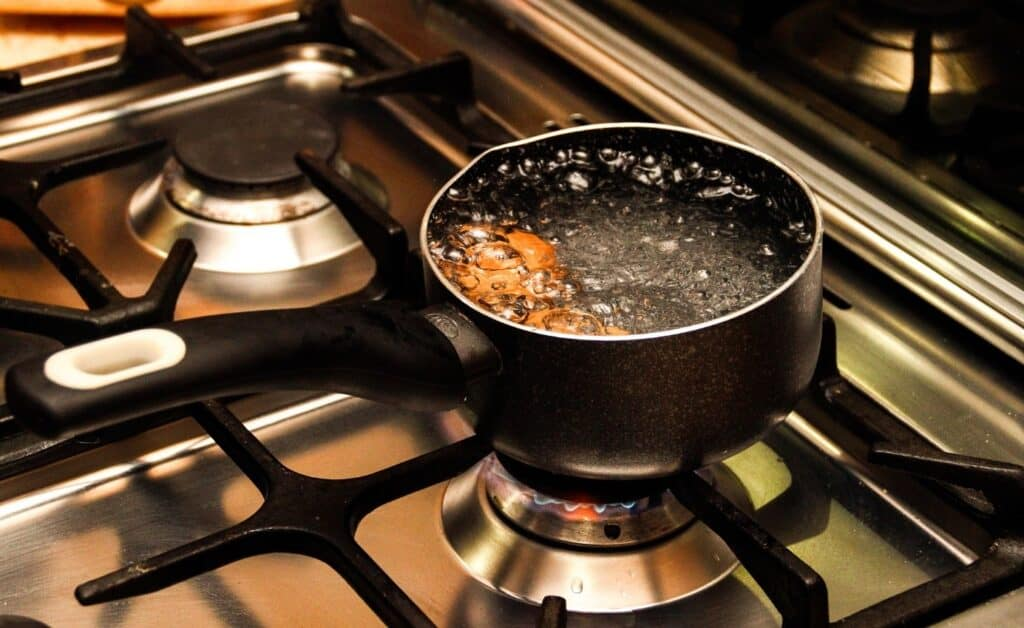 sausage in boiling water