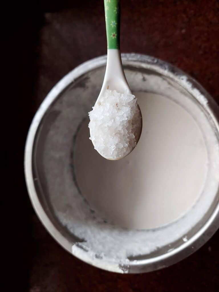 adding rock salt to dosa batter