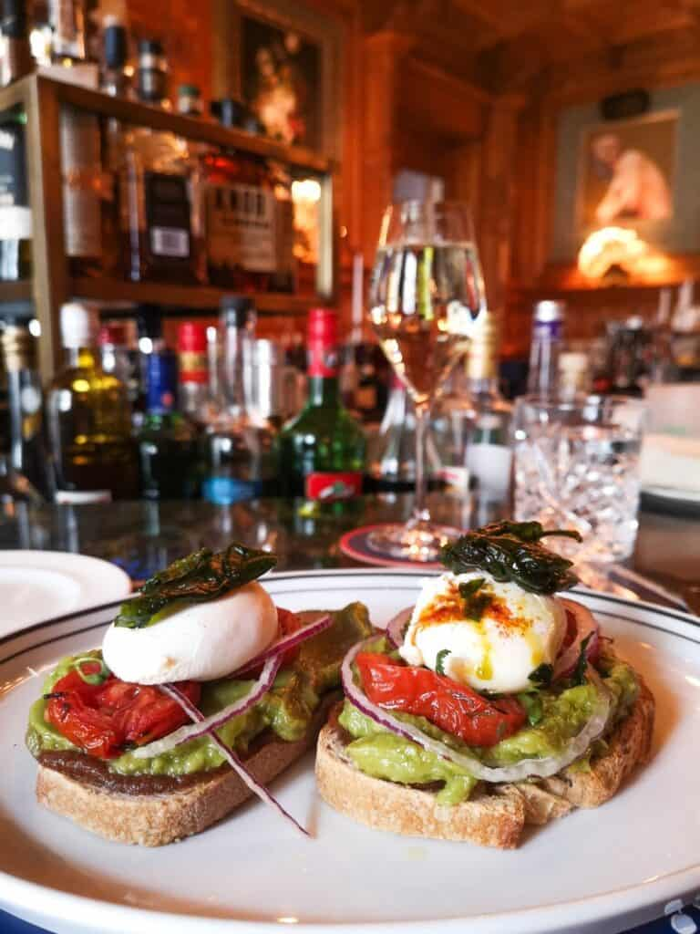 poached egg and avocado toast sandwich