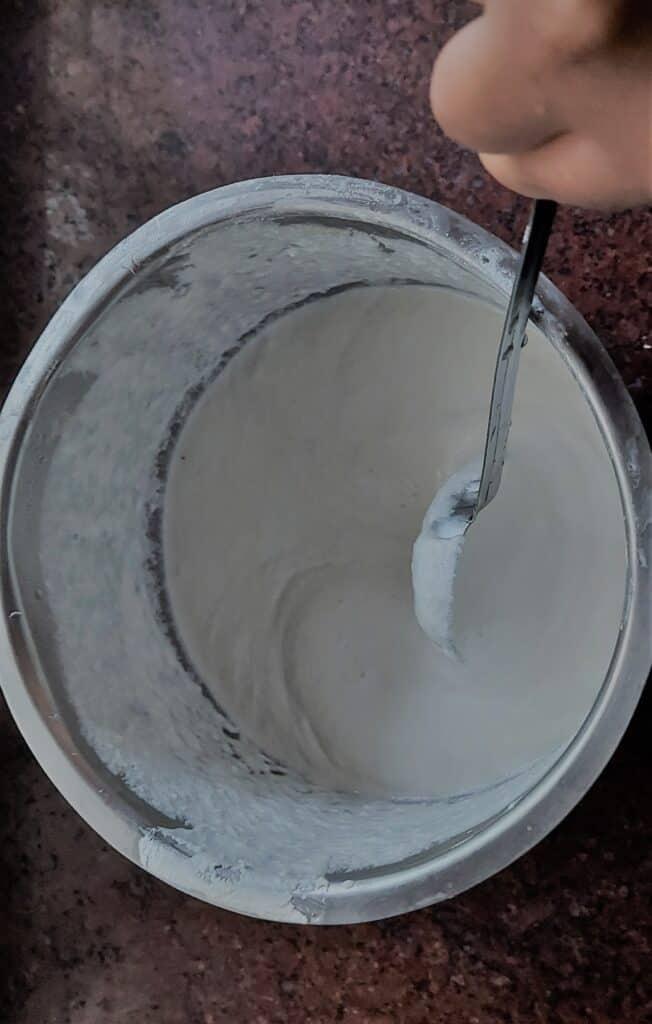 stirring the dosa batter